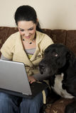 Woman and dog with laptop Stock Photo