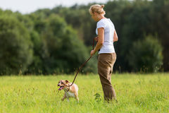 Woman with a dog at the leash royalty free stock photos