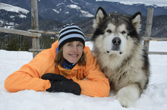 Woman with dog-malamute Stock Images