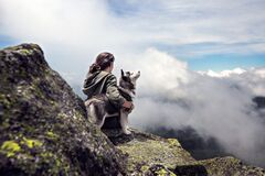 Woman and dog in mountains