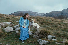 Woman with a dog in the mountains Stock Photos