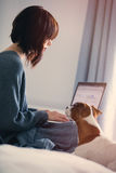 Woman with dog and notebook Royalty Free Stock Images