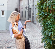Woman with dog in old city Royalty Free Stock Image