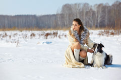 Woman with dog outdoors Royalty Free Stock Image