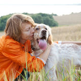 Woman with dog outdoors Royalty Free Stock Images