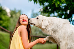 Woman with dog outdoors Stock Image