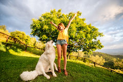 Woman with dog outdoors Royalty Free Stock Photography