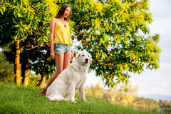 Woman with dog outdoors Royalty Free Stock Photo