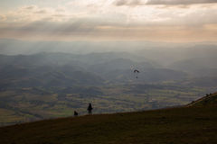 Woman, dog and paraglider royalty free stock photos