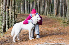 The woman with a dog in a park Stock Photo