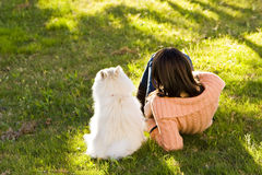 Woman and dog in the park Royalty Free Stock Image