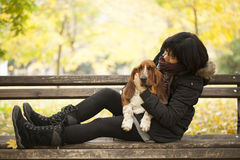 The woman with a dog in the park Stock Images