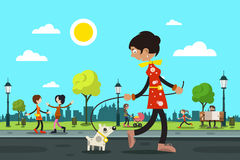 Woman with Dog and People in City Park Stock Photo