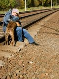 A woman with a dog on the railroad Royalty Free Stock Photos