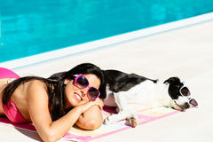 Woman and dog relaxing on summer Stock Images