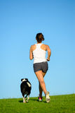 Woman and dog running at park outdoor Royalty Free Stock Photography