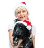 Woman and dog in santa hats Royalty Free Stock Photo