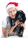 Woman and dog in santa hats Royalty Free Stock Photography