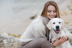Woman with dog on the sea shore stock images