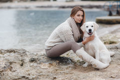 Woman with dog on the sea shore stock photography