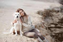 Woman with dog on the sea shore royalty free stock photo
