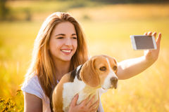 Woman and dog selfie Stock Images