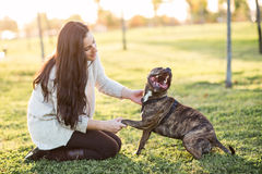 Woman and dog shaking hand and paw Royalty Free Stock Photography