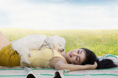 Woman and dog sleeping on the meadow Royalty Free Stock Image