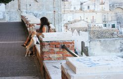 Woman with a dog in the street, Italy Royalty Free Stock Photo
