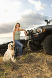 Woman and Dog by SUV at the Beach Royalty Free Stock Photography
