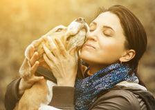 Woman and dog tender hugs Stock Photo