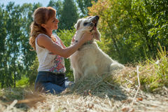 Woman and dog together Stock Photography