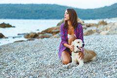 Woman with a dog on a walk on the beach Stock Photography