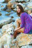 Woman with a dog on a walk on the beach Stock Images