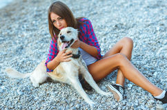 Woman with a dog on a walk on the beach. Summer vacation - woman with a dog on a walk on the beach Stock Images
