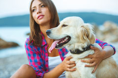 Woman with a dog on a walk on the beach Royalty Free Stock Photos