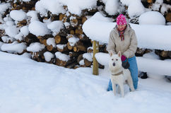Woman with a dog on walk in a winter wood Stock Photo