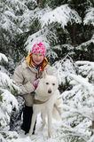 Woman with a dog on walk in a winter wood Royalty Free Stock Photos