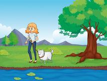 A woman with a dog walking along the river Royalty Free Stock Photo