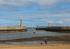 Woman and dog Whitby harbour Royalty Free Stock Images