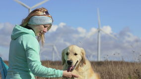 Woman, dog and wind turbines. stock video footage