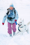 The woman with a dog in winter Royalty Free Stock Photo