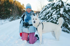 The woman with a dog in winter Royalty Free Stock Photos
