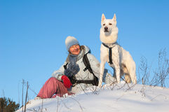 The woman with a dog in winter Stock Photography