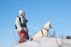 The woman with a dog in winter Royalty Free Stock Photography