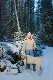 Woman with dog in winter forest Stock Photography