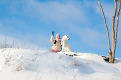 Woman with a dog in winter on walk Stock Photography