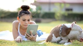 Woman with dog. And holding a tablet stock video footage