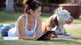 Woman with dog. Woman writh notebook and dog stock video footage