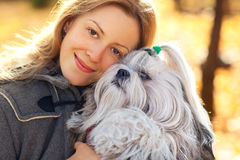 Woman with dog. Young woman with favorite dog royalty free stock photography